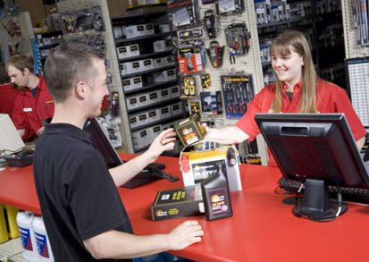 Auto Value Parts Store Retail exchange between customer and employee
